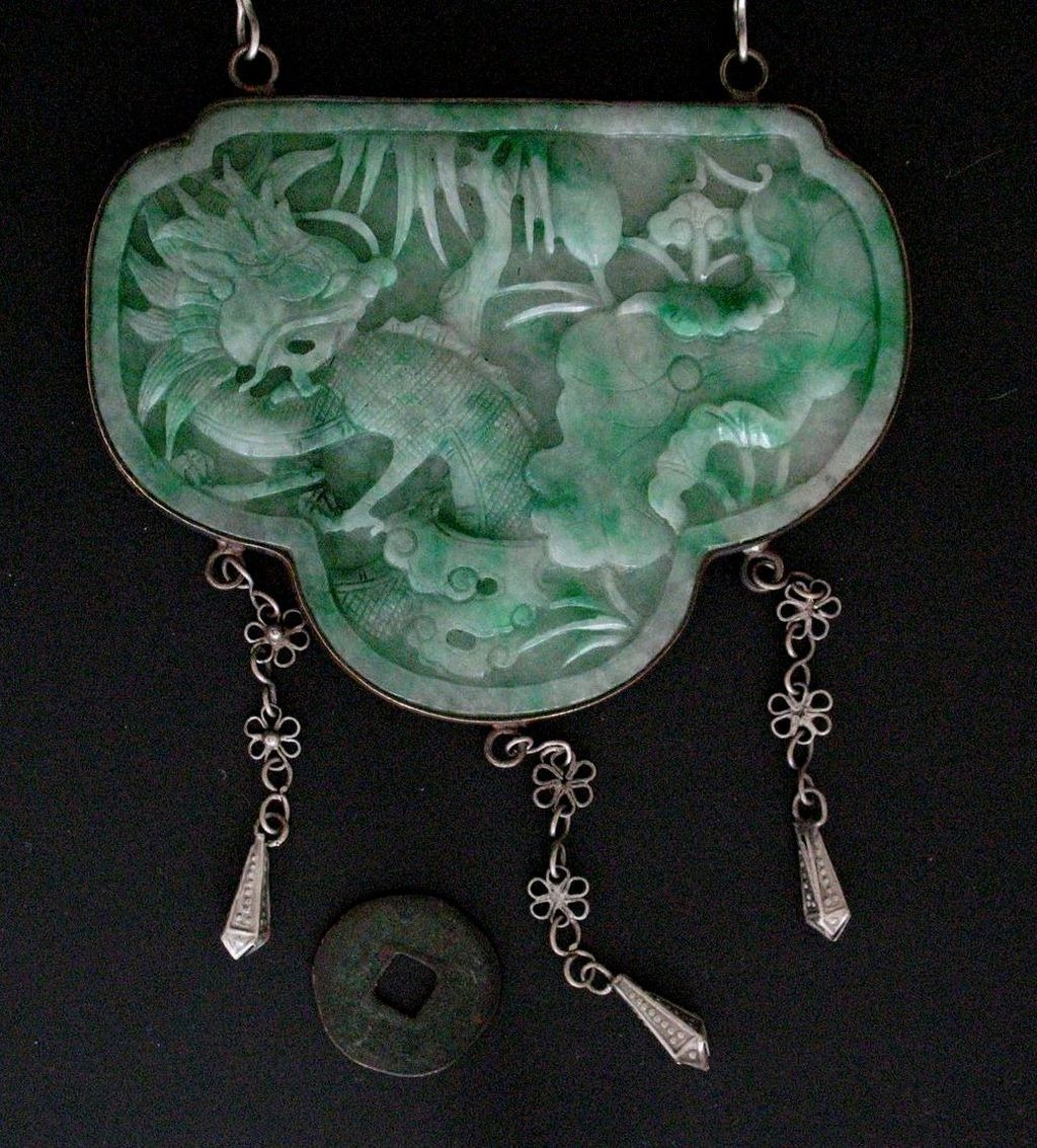 Chinese carved jade pendant 19thc privatecollection chinese carved jade pendant 19thc aloadofball Images