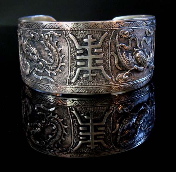 07-10-01 Chinese Carved Silver Four Ling Bracelet